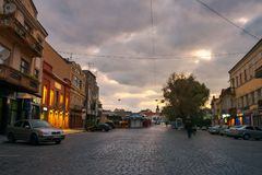 Petefi square on a cloudy autumn sunrise. Uzhgorod, Ukraine - SEP 28, 2008: Petefi square on a cloudy autumn sunrise. old town awaiting for tourists crowds stock photography