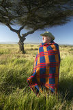Peter Bender in Senior Elder robe of Masai standing near Acacia Tree in the Lewa Conservancy of Kenya Africa Royalty Free Stock Image
