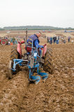 Peter Carman, Ploughman. BASINGSTOKE, UK - OCTOBER 12, 2014: Peter Carman competing on a Massey Ferguson tractor in the second day of the British National Royalty Free Stock Photo