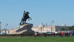 Peter The Great sculpture Horseman and a group of tourists in the summer Stock Photo
