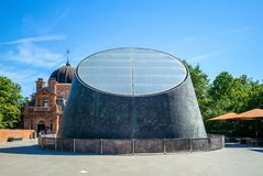 Peter Harrison Planetarium in greenwich park. The Peter Harrison Planetarium is a 120-seat digital laser planetarium, situated in Greenwich Park, London and is royalty free stock photo