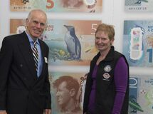 Peter Hillary and a representative of the Yellow-Eyed Penguin Trust New Zealand royalty free stock image