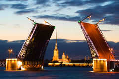 Peter and Paul Cathedral in the alignment of the diluted Palace Bridge at white night. Saint-Petersburg Stock Photography