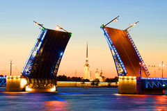 Peter and Paul Cathedral on the background of divorced Palace bridge in white night. St. Petersburg Stock Images