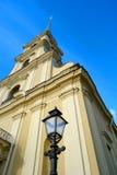 Peter and Paul Cathedral, Saint Petersburg, Russia. The spire of the Peter and Paul Cathedral and the street lamp Stock Image