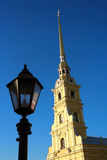 The Peter and Paul Cathedral. The spire of the Peter and Paul Cathedral and the street lamp Stock Photo