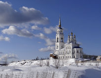 Peter and Paul Church in Severouralsk. Sverdlovsk region. Russia. Severouralsk, Sverdlovsk region, Russia - March 30, 2013: The two-story white stone building Royalty Free Stock Image