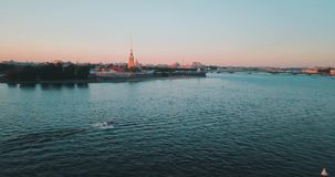 Peter and Paul fortess Aerial view of sunset over Neva river in Saint Petersburg, Russia. Vasilievskiy island city from. Above, cinematic drone video stock video