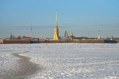 Peter and Paul fortress and footpath on the ice of the Neva rive. R in winter on a Sunny day in Saint-Petersburg Stock Photography
