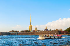 Peter and Paul fortress at Hare island with touristic sailboat at Neva river in St Petersburg, Russia Stock Photos