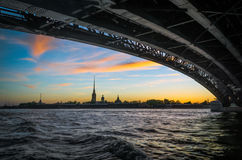 Peter and Paul Fortress on the Neva River in the evening at sunset view from under the bridge in the twilight in St. Petersburg Royalty Free Stock Photos