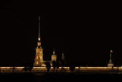 Peter and Paul fortress by night. Famous cathedral tower, highest building of St.Petersburg stock photography
