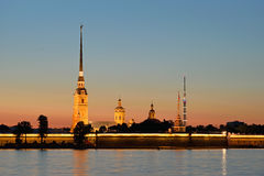 Peter and Paul fortress with the Palace promenade at sunset Stock Images