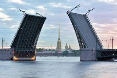 Peter and Paul fortress and raised Palace bridge in summer white nights, St. Petersburg Stock Photos