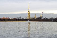 Peter and Paul fortress with it reflection in cold Never river waters. View of Peter and Paul fortress with it reflection in cold Neva river waters and white Stock Image