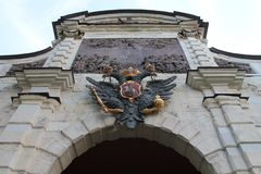 Russian coat of arms over the arch of the Peter Gate. Peter-Pavel`s Fortress. St. Petersburg. royalty free stock image