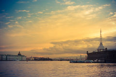 Peter and Paul& x27;s fortress on sunset, St. Petersburg, Russia. Walk along the promenade evening St. Petersburg Royalty Free Stock Photo