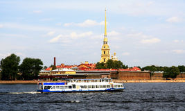 Peter-Pavel`s Fortress in St. Petersburg. Russia. St. Petersburg. Tourist boat on the background of the Peter-Pavel`s Fortress located in the city center on Stock Photography