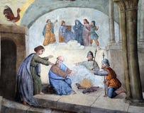 Peter verweigert Jesus vor den Hahnkrähen dreimal Stockbilder