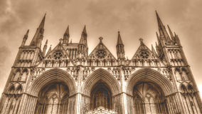 Peterborough Cathedral West Facade low angle HDR Sepia Tone Stock Photo