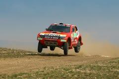 Peterhansel jumping. 9 times Dakar winner Stephane Peterhansel jumping on Central Europe Rally Royalty Free Stock Images