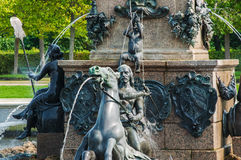 Peterhof Palace St Petersburg, Russia. Details of Neptune fountain in Upper Garden. The Peterhof Palace included in the Stock Photo