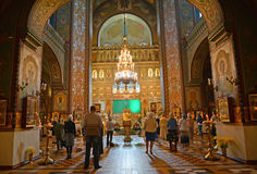 PETERHOF, RUSSIA. Believers stand on church service in Saint Pyotr and Pavel's cathedral. PETERHOF, RUSSIA - JULY 24, 2015: Believers stand on church service in stock photo