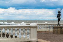 Peterhof, Russia - June 03. 2017. The sculpture of Neptune on embankment of Gulf of Finland Royalty Free Stock Photo