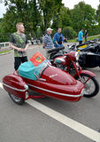 PETERHOF, RUSSIA. The old Czechoslovak Java motorcycle (Jawa) with the side trailer costs at a street exhibition. PETERHOF, RUSSIA - JULY 26, 2015: The old stock photo