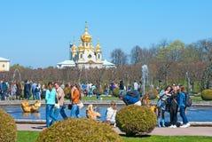 Peterhof. Russia. People near Mezheumniy Fountain Royalty Free Stock Photo
