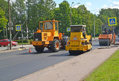 PETERHOF, RUSSIA. Road cars work at laying of new asphalt Royalty Free Stock Photography