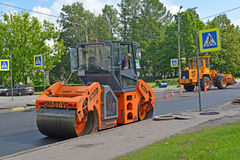 PETERHOF, RUSSIA. Road cars work at laying of new asphalt Stock Image