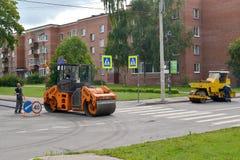 PETERHOF, RUSSIA.Road skating rinks work at asphalt laying Royalty Free Stock Photo