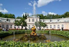 PETERHOF, RUSSIA. The Triton Who Is Breaking Off a Mouth to a Sea Monster fountain. PETERHOF, RUSSIA - JULY 24, 2015: The Triton Who Is Breaking Off a Mouth to a Royalty Free Stock Image