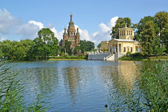 PETERHOF, RUSSIA. A view of a cathedral of Saints Pyotr and Pavel and Tsaritsyn the pavilion on the bank of Holguin of a po Stock Image