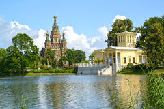 PETERHOF, RUSSIA. A view of a cathedral of Saints Pyotr and Pavel and Tsaritsyn the pavilion on the bank of Holguin of a pond Royalty Free Stock Photography