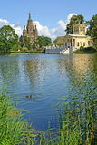 PETERHOF, RUSSIA. A view of a cathedral of SaintSaints Pyotr and Pavel and Tsaritsyn the pavilion on the bank of Holguin of a pond Royalty Free Stock Photography
