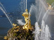 Grand Cascade in Peterhof, St. Petersburg, Russia. Peterhof, St. Petersburg, Russia - June 4, 2017: Golden statues of the Grand Cascade. The cascade was built in Stock Photos