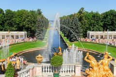 Peterhoff Palace Fountain. Peterhof, the Summer Palace. Looking down upon the channel and the powerful fountains with Samson Royalty Free Stock Photos