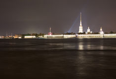 Peters and Paul fortress night view. Shot from the Troitskiy Most (Trinity Bridge) basement though the Neva river. Its one of the finest views of Saint royalty free stock images