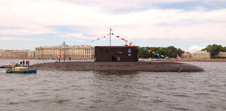 PETERSBURG-JULY 26: Naval parade. Panorama. PETERSBURG-JULY 26: Naval parade by day of navy fleet of Russia. Submarine on the river Neva. July 26, 2009 in Saint Royalty Free Stock Images