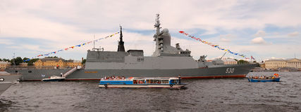 PETERSBURG-JULY 26: Naval parade. Panorama. PETERSBURG-JULY 26: Naval parade by day of navy fleet of Russia. A destroyer Steregushiy on the river Neva. July 26 Stock Images