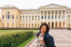 Petersburg, Russia - June 30, 2017: girl cheerful tourist. Petersburg, Russia - June 30 2017 girl cheerful tourist royalty free stock photo