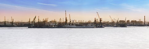 Petersburg. Seaport. Russia.View from the Gulf of Finland covered with ice. Panorama Royalty Free Stock Photo