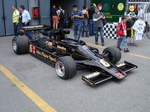 Peterson's Lotus 78. 1977 Lotus 78 driven by Mario Andretti and Ronnie Peterson in the formula one world championship. This car has been photographed behind Royalty Free Stock Photos
