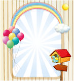 A pethouse near an empty template with balloons and rainbow Stock Photo