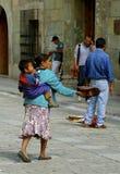 Petición de la mujer con el niño Fotos de archivo