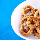 Petisco cozido dos anéis de cebola Foto de Stock Royalty Free
