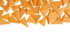 Petisco do milho na forma do chifre como a beira decorativa isolada no fundo branco Imagem de Stock