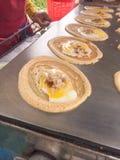 Petisco do Tóquio Ovo e galinha com a salsicha envolvida acima com farinha Fotos de Stock Royalty Free